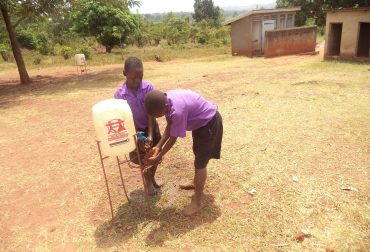 Children at Kiwagama PS Using a Hand Washing Facility provided by NEMACY-UGANDA