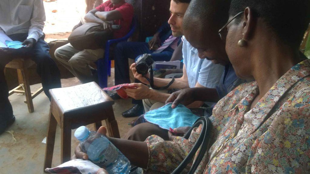 Mr. Christof Seiler the Coordinator of MIVA Switzerland and the CEO NEMACY-Uganda got impressed after receiving a sample of the reusable sanitary pads made by trained child mothers in Buwenge town council during a courtesy visit to them.
